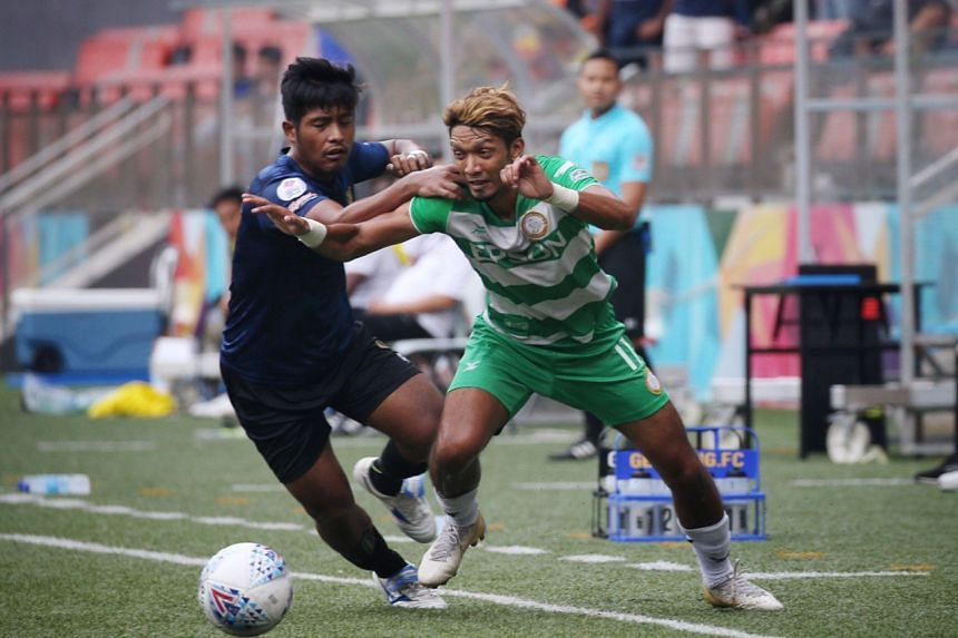 Geylang International's Fareez Farhan (right) tussling for the ball with Hougang United's Afiq Noor during their SPL football match at Our Tampines Hub on Sept 15, 2019.