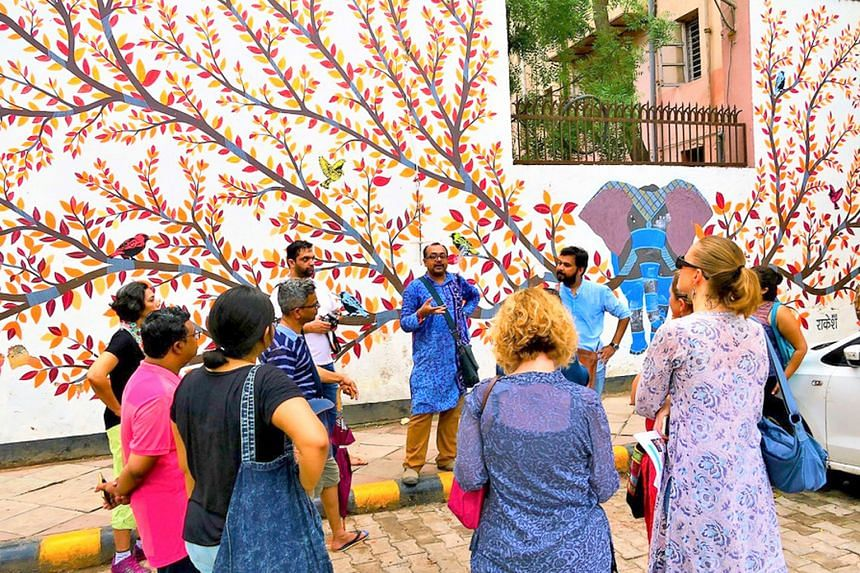 Delhi By Foot's Mr Ramit Mitra leads a walk in Delhi's Lodhi Art District, the first open-air public art space in the city.