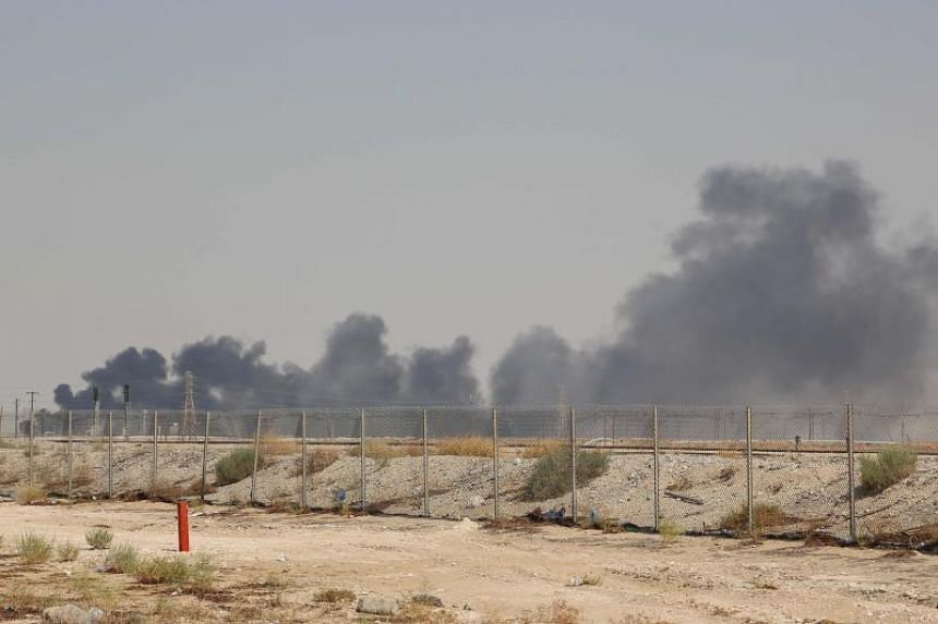Smoke billowing from an Aramco oil facility in Abqaiq, following a drone attack, on Sept 14, 2019.
