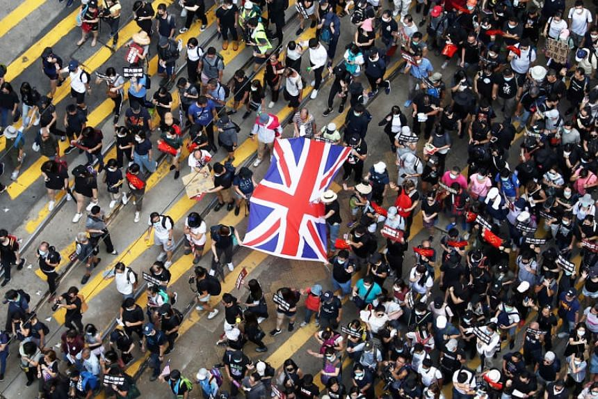 Anti-government demonstrators in Causeway Bay holding up a Union Jack during a protest on Sept 15, 2019.