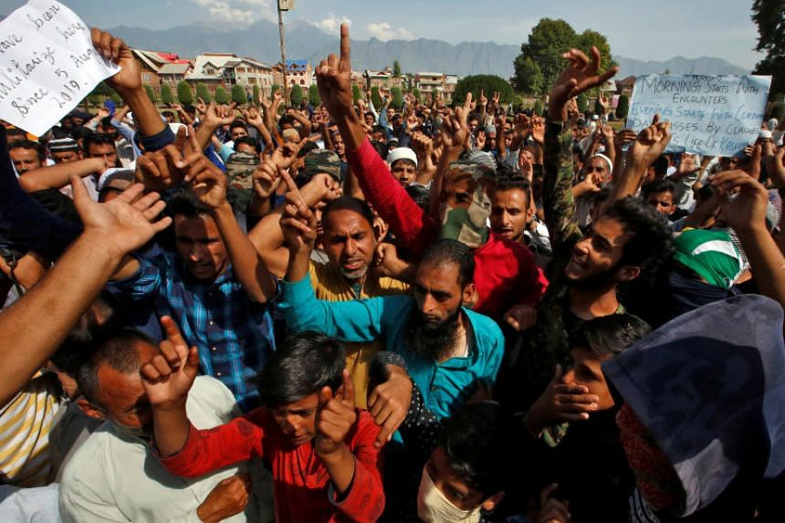 Kashmiris shouting slogans at a protest site after Friday prayers in Srinagar, on Sept 13, 2019.
