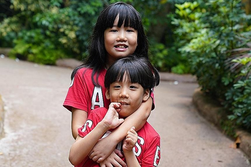 Charmeine Lee Kai En, 10, received an award for being an exemplary sibling to her brother, Bryan Lee Kai Jie, seven.