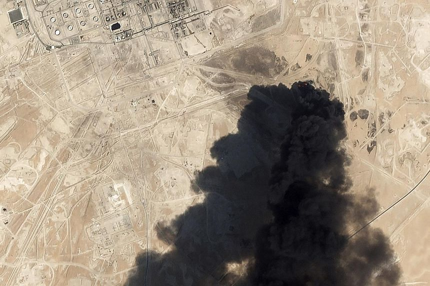 Thick smoke rising from Aramco's Abqaiq oil processing facility in Saudi Arabia, last Saturday, in a satellite image from Planet Labs. The attack, as well as one on Khurais, the kingdom's second-biggest oil field, was claimed by Iran-backed Houthi re