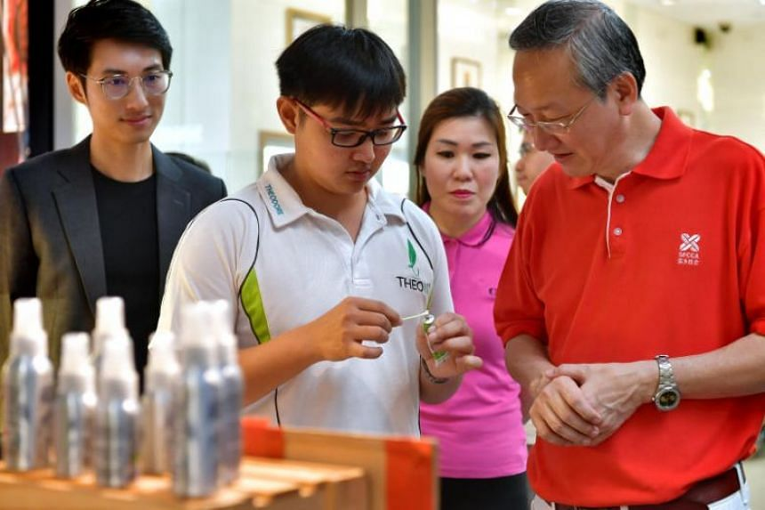 Theo10 founder Theodore Khng showcasing his company's products to Minister of State for the Ministry of Social and Family Development Sam Tan, on Sept 15, 2019.