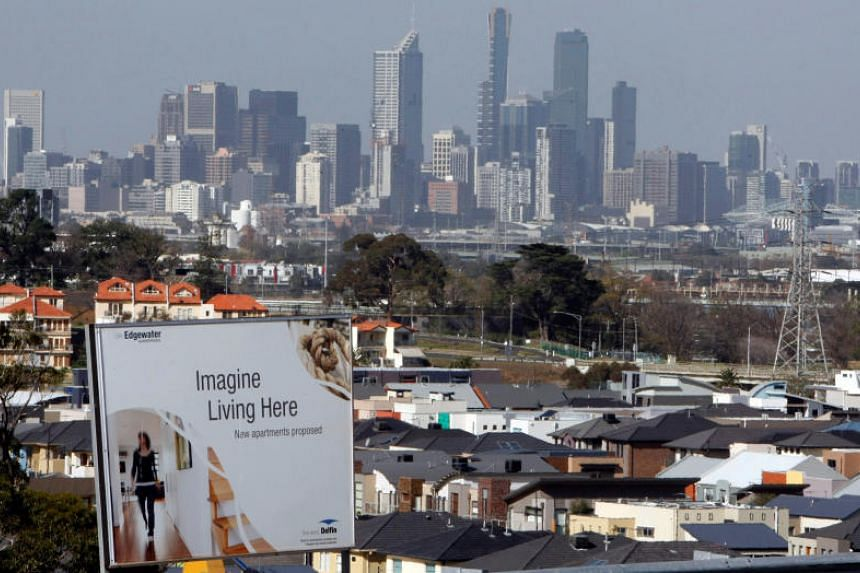 An advertising sign for a new housing development area is seen with the Melbourne skyline. The ''wealth effect' of rising home prices has hardly been felt across the rest of the Australian economy.