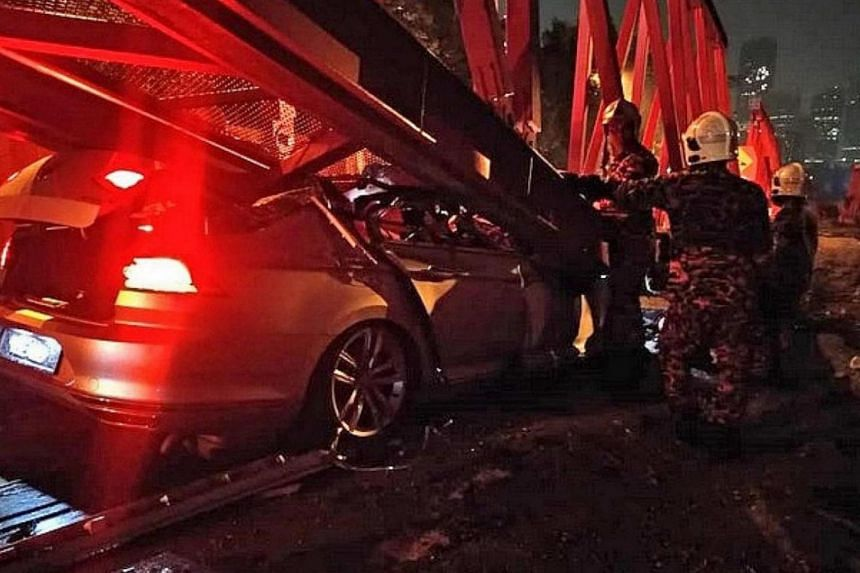 Mr Chua Zhijian's Volkswagen Passat skidded after grazing a motorcycle and crashed into a water-filled road barrier.