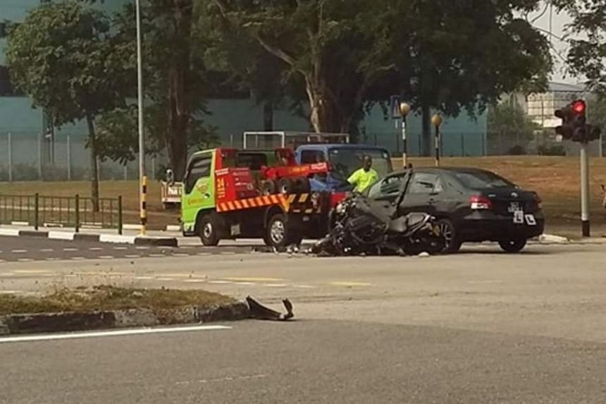 Picture of the accident's aftermath show a black motorcycle lying on its side on the road beside a black car which has a front side door badly dented.