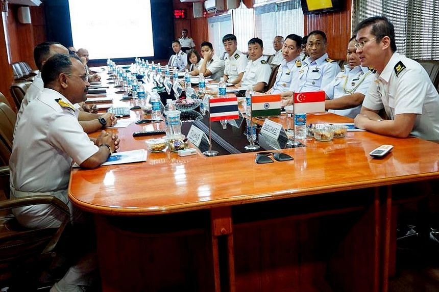 Lieutenant-Colonel Michael Chan (right), commanding officer of the Republic of Singapore Navy's RSS Tenacious, one of the five ships taking part in the five-day Singapore-India-Thailand Maritime Exercise, at a planning exercise with other drill parti