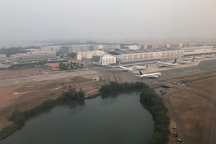Conditions in the Changi area at 6.30pm yesterday. The 24-hour PSI reading in the east at 7pm was 76 (moderate). Singapore got a breather when the winds changed direction on Sunday to blow from the south-east. ST PHOTO: NEO XIAOBIN