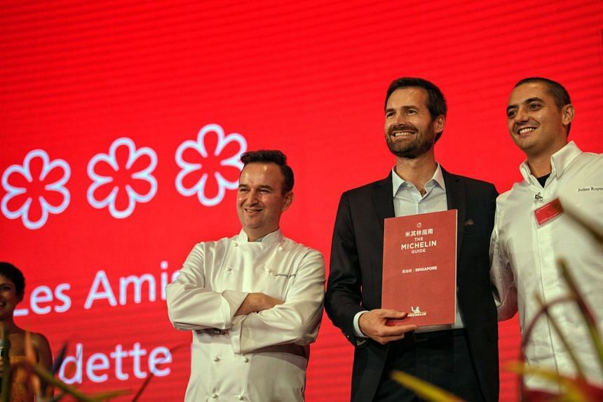 Chef Sebastien Lepinoy (left) and Chef Julien Royer after getting their three stars on Sept 17, 2019. Gwendal Poullennec, the new international director of the Michelin Guides, is in the centre.