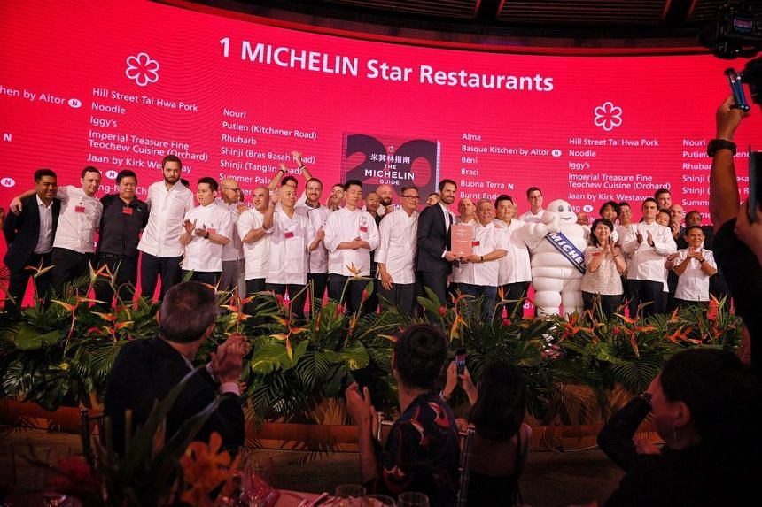 The chefs of restaurants awarded one Michelin star in a group picture after the ceremony on Sept 17, 2019.