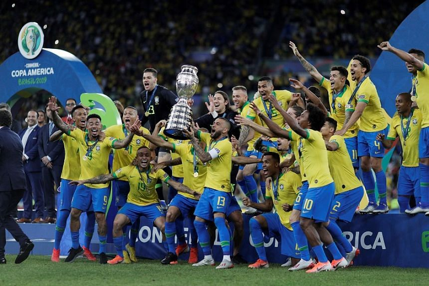 Brazil's national football team celebrating their Copa America win with the trophy on July 7, 2019. They are set to play two friendlies at Singapore's National Stadium next month.