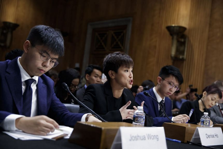 (From left)  Joshua Wong, Denise Ho, spokesman for the Hong Kong Higher Education International Affairs Delegation Sunny Cheung and executive director of Human Rights in China Sharon Hom deliver remarks on Capitol Hill in Washington.