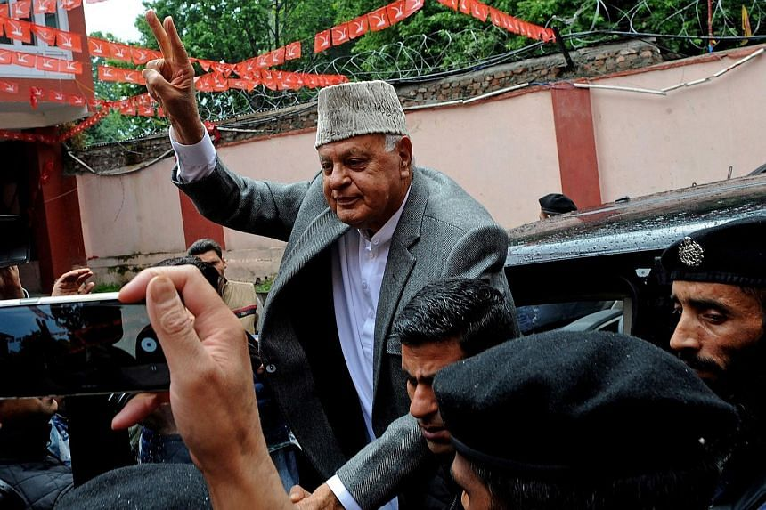 In this photo taken on May 23, Mr Farooq Abdullah, former chief minister of Jammu and Kashmir, flashes a victory sign after winning a Parliament seat. PHOTO: AGENCE FRANCE-PRESSE