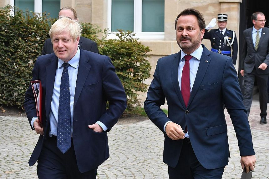 British Prime Minister Boris Johnson and Luxembourg Prime Minister Xavier Bettel leaving a Brexit meeting on Monday. Mr Johnson bowed out of a news conference with Mr Bettel on Monday amid intense public protests.