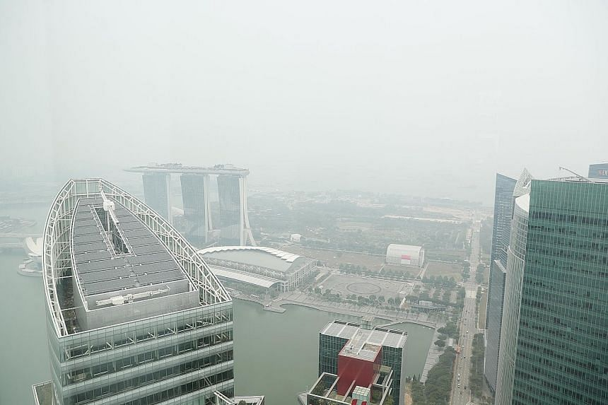 Haze in the southern part of Singapore yesterday afternoon. The problem is expected to continue in the next few days as the hot-spot activities in Sumatra are likely to persist. ST PHOTO: KELVIN CHNG