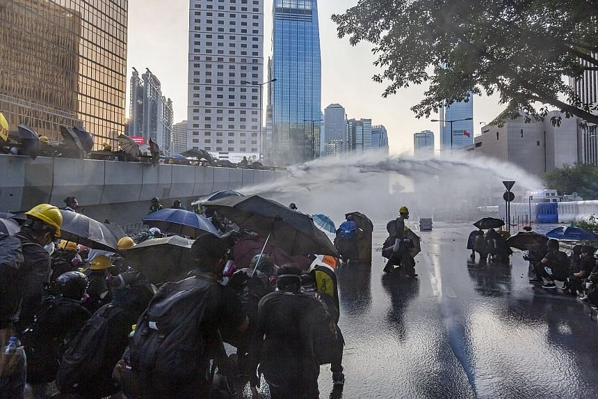 Hong Kong police using water cannon on protesters on Sunday. As protests stretch into the fourth month, new digital banks, seen triggering the biggest shake-up in Hong Kong's retail banking sector in years, will now be launched early next year, sourc