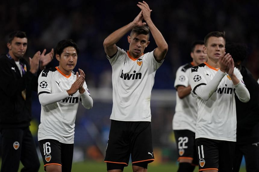 Valencia's players celebrate after wining the Uefa Champions League Group Stage H soccer match between Chelsea and Valencia at Stamford Bridge in London, on Sept 17, 2019.