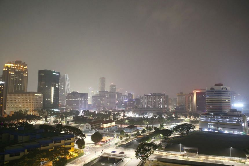 A view of the haze in the city area as seen from Block 30 Kelantan Road at around 11pm on Sept 18, 2019.