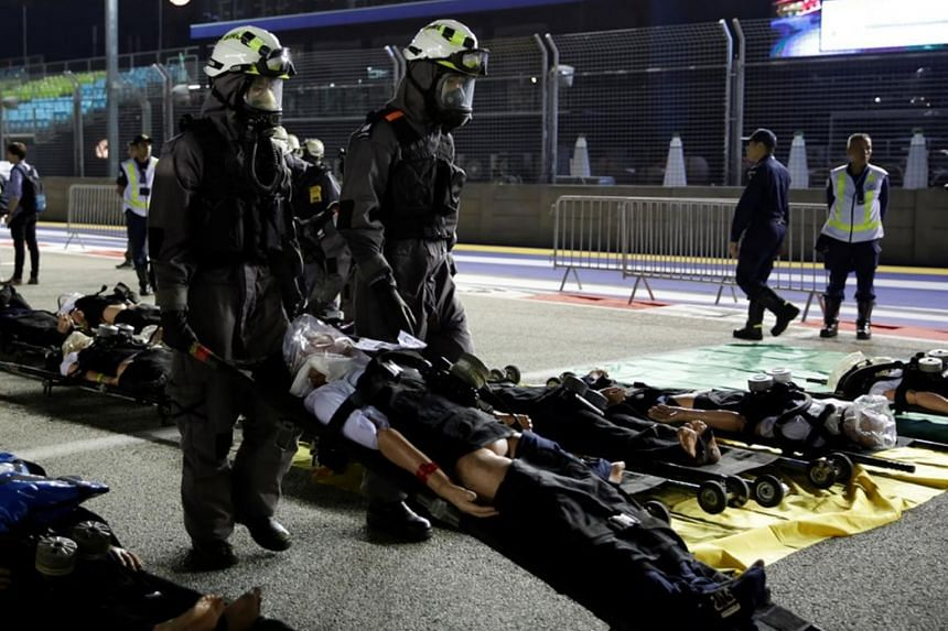The exercise at the F1 Singapore Airlines Singapore Grand Prix race circuit involved over 150 participants and 29 emergency vehicles. SCDF personnel were clad in protective gear attending to dummy spectators, such as covering the dummies' faces with