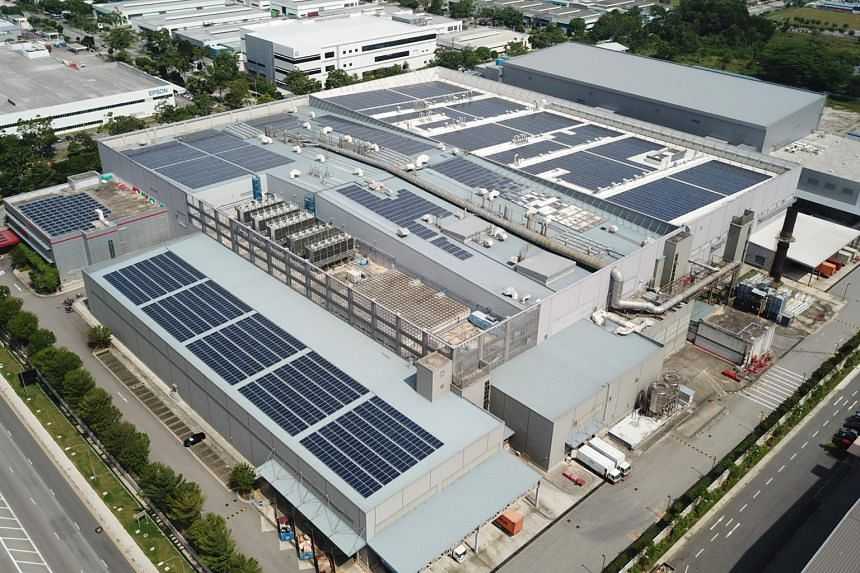 A solar farm on the roof of 3M's manufacturing plant in Tuas.