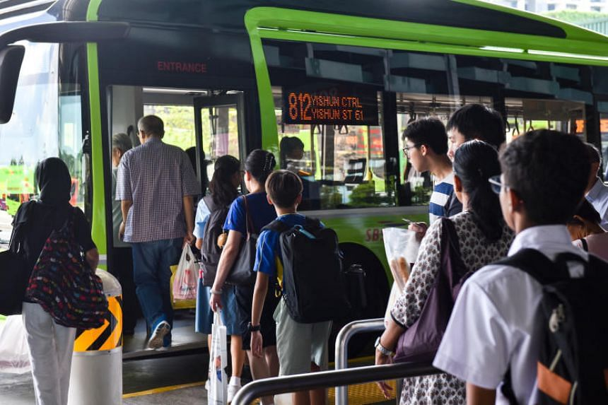 Passengers boarding a bus in Yishun bus interchange on Feb 11, 2019.