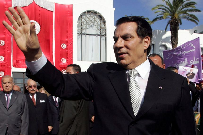 A 2009 photo shows Ben Ali waving to supporters after he took the oath of office at the national assembly in Tunis.