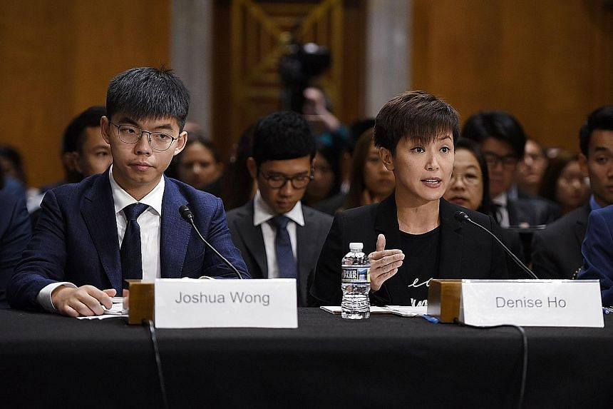 Hong Kong student leader Joshua Wong and singer-actress Denise Ho testifying before a bipartisan congressional commission about the pro-democracy movement in Hong Kong on Capitol Hill on Tuesday.