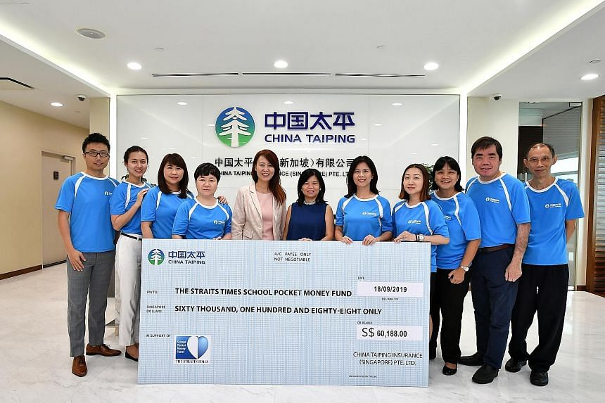 China Taiping Insurance Singapore deputy general manager Lynn Lee (fifth from left) presenting a cheque for $60,188 to STSPMF general manager Tan Bee Heong (centre) at China Taiping's office yesterday.