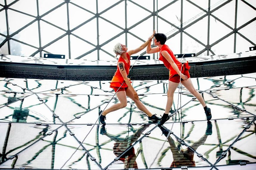 For their performance, six dancers, tethered to the wall with rope and harnesses, will be suspended from the fifth floor of the Ion Orchard.