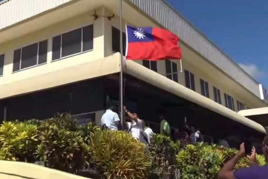 The Taiwan flag being lowered at its embassy in Honiara, Solomon Islands, on Sept 17, 2019, in this still image taken from social media.