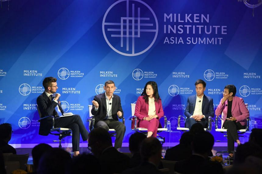 (From left) Mr Jonathan McClory, moderator of the panel discussion on the fight against fake news at the Milken Institute Asia Summit 2019, with Warren Fernandez, editor of The Straits Times; Ellana Lee, senior vice-president at CNN International; Ga
