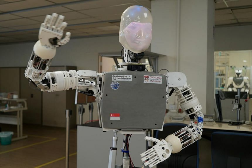A robot named EDGAR, short for Expressions Display and Gesturing Avatar Robot, waving at a laboratory in Singapore, on Aug 14, 2019.