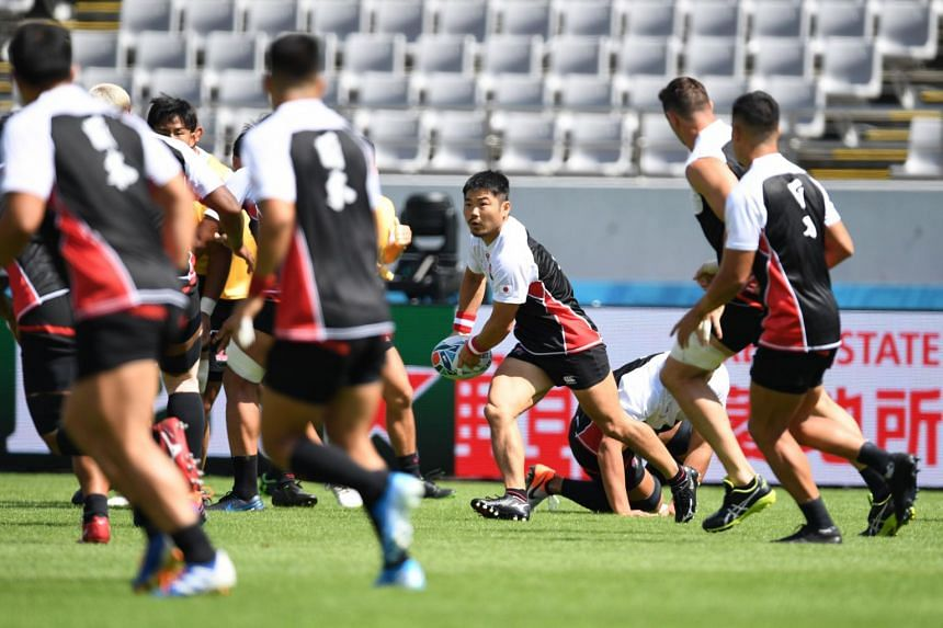Japan's rugby team at a training session in Tokyo stadium, on Sept 19, 2019.