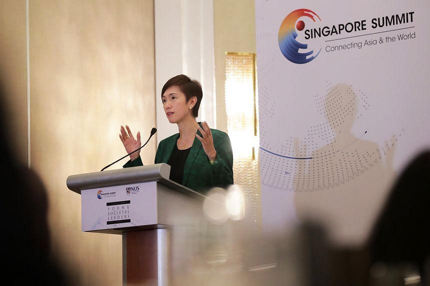 """Manpower Minister Josephine Teo said that whatever the Fourth Industrial Revolution may mean to businesses and industry, """"a focus on workers and a focus on jobs and skills ought to be at front and centre of everything we do""""."""