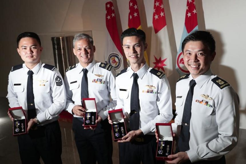 (From left) Staff sergeant Keith Ho Kee Hou, Military Expert 4 Brian Rezel, Major Jason Chai and Lieutenant-Colonel Oh Chun Keong with their Overseas Service Medals.