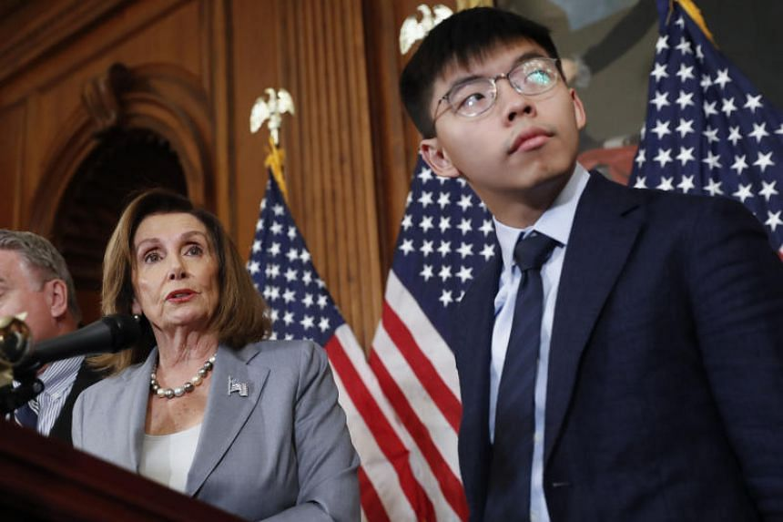 US congressional leader Nancy Pelosi with Hong Kong activist Joshua Wong during a news conference on Capitol Hill in Washington on Sept 18, 2019.