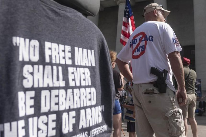 Gun owners and second amendment advocates gather at the Ohio State House to protest against gun control legislation in Columbus, Ohio, on Sept 14, 2019.