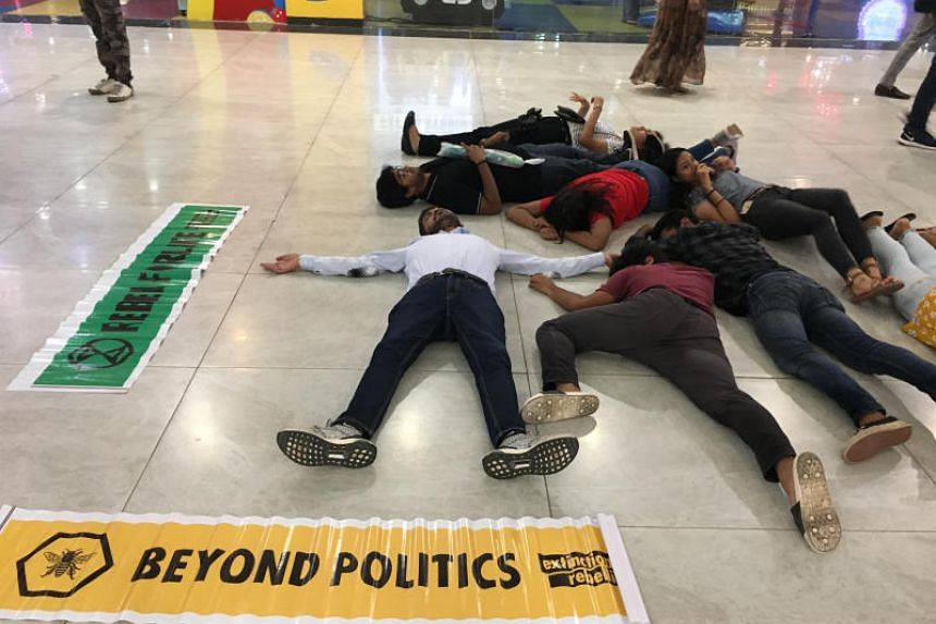 """XR volunteers stage a """"die-in"""" at a mall in Chandigarh."""