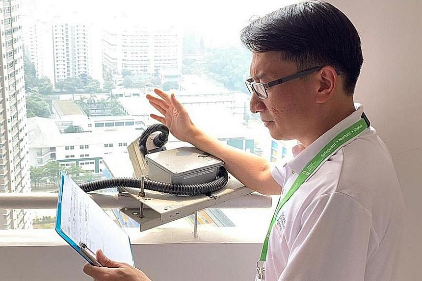 Mr Halmie Hussein Mattar with a camera used to investigate a high-rise littering case. When one area becomes a consistent concern, National Environment Agency officers may scope it out for suitable vantage points to place cameras. Investigators have