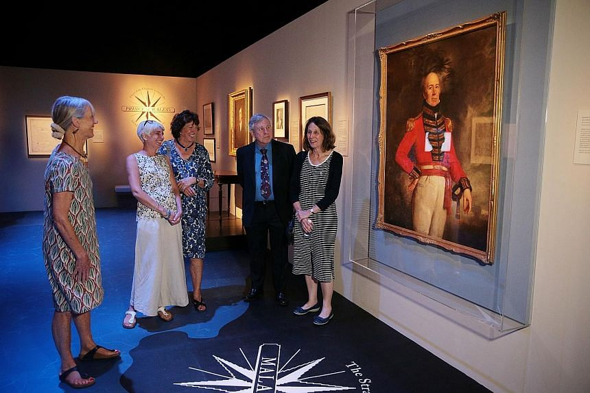 William Farquhar's descendants (above, from left) Ms Jane Ready, 71, Ms Morag Sutcliffe, 56, Ms Sally Richards, 74, Mr Anthony Lumsden, 71, and Ms Heather Lumsden, 67, before his portrait. They and the descendants of Stamford Raffles are in town for