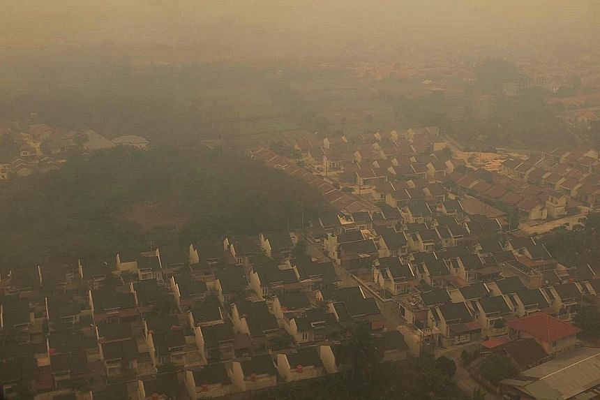 Pekanbaru, in Indonesia's Riau province, is one of the areas hit hard by the haze. This scene of the haze-shrouded city was taken by a Straits Times photographer as he flew in.