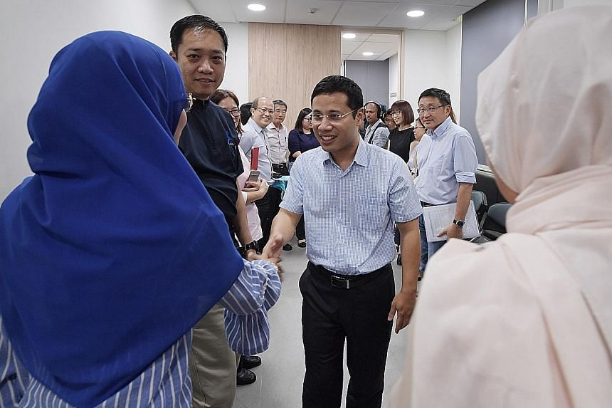 Minister for Social and Family Development Desmond Lee meeting divorce counsellors at the Ang Mo Kio Family Service Centre yesterday. He said judges needed to be empowered further to ensure disputes in divorce cases do not become a zero-sum game. ST