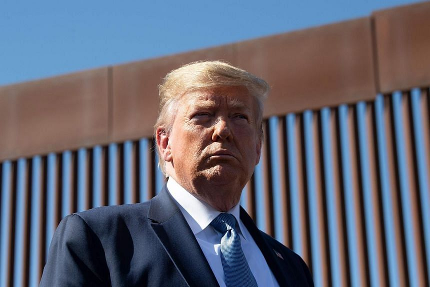 In a photo taken on Sept 18, US President Donald Trump visits the US-Mexico border fence in Otay Mesa, California. Mr Trump has nominated Ms Barbera Hale Thornhill of California to be ambassador to Singapore.