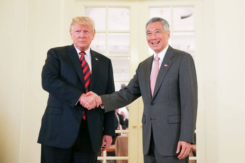 Prime Minister Lee Hsien Loong with US President Donald Trump before a working lunch at the Istana in Singapore on June 11, 2018.