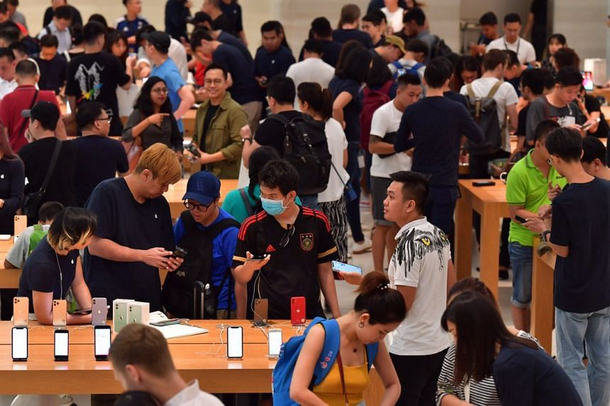 Crowds check out the new phones at the Apple store in Orchard Road on Sept 20, 2019.