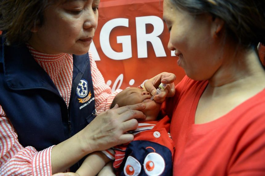 A health worker administers a polio vaccine during an anti-polio campaign in Manila, on Sept 20, 2019.