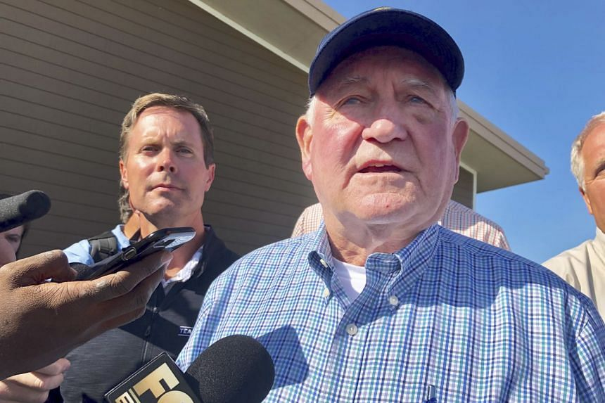 An August 2019 photo shows US Agriculture Secretary Sonny Perdue speaking to reporters in Illinois.
