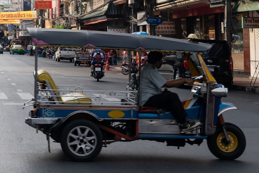 A prototype of the self-driving tuk-tuk (left) in the gated community where the months-long trial will run and the usual tuk-tuk zipping through a Bangkok street (right). The tuk-tuk was chosen as a test vehicle because it is, among other reasons, mo