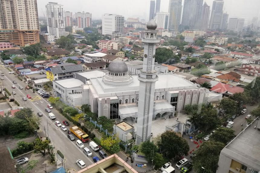 The sprawling 119-year-old Kampung Baru (foreground) contains old village homes on small plots of land to rundown apartments.